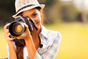 attractive young woman with a camera
