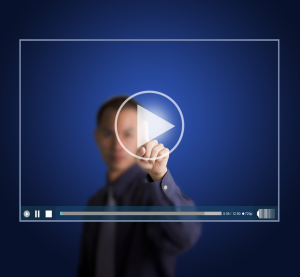 Conceptual Image of a Man Clicking on a Video Icon