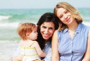 Lesbian Couple and their Daughter Pose for a Relaxed Family Portrait