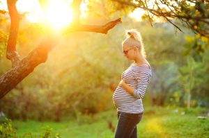 Outdoor Shot of Stylish Pregnant Woman in Striped Top